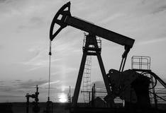 Oilfield during sunset Stock Photo