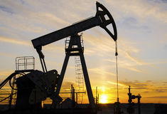 Oilfield during sunset Stock Photography