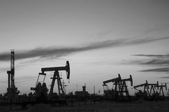 Oilfield during sunset Stock Images