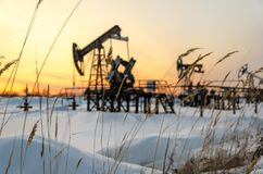 Oilfield during sunset in winter time stock photo