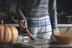 Oiling the backing dish for pumpkin dump cake Stock Image