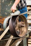 Oiling Belt Shaft Bearing. Vintage belt drive shaft getting oiled Stock Image