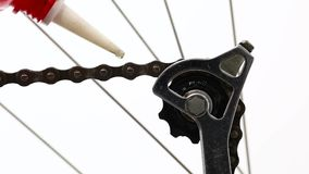 Oiling a bike chain stock footage