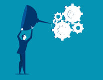 Oiling the gears. Businessman oiling  Stock Images