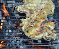 Oiling Grilled chicken Royalty Free Stock Image