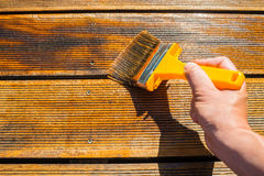 Oiling Terrace with Wide Brush Stock Image