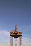 Oilrig. An oilrig against a blue sky, some clouds Royalty Free Stock Photo