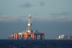 Oilrig. Two offshore oilrigs and tanker Royalty Free Stock Image