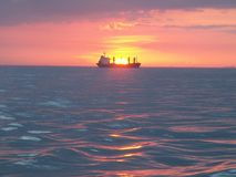 Oiltanker at sea during sunset Stock Photos