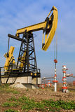 Oilwell. On the landscape. Industrial background Royalty Free Stock Photo