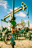 Oilwell and pump jack. Royalty Free Stock Image