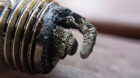 Oily and charred car sparkplug macro photo. Oily and charred well used car sparkplug macro photo stock photography