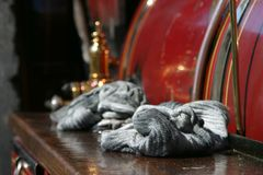 Oily cloths left on steam engine. Oily cloths left on the side of a vintage steam engine at Enfield London Steam Fair, direct sunlight Royalty Free Stock Images