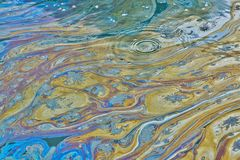 Oily pollution film covering the surface of a Texas waterway. stock images