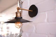 oin för lamptappningdesign väggen Royaltyfri Foto