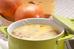 Oinion soup with melted cheese and bread on top Royalty Free Stock Photography