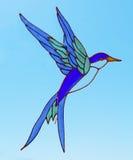 Oiseau en verre souillé photographie stock libre de droits