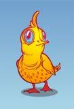 Oiseau jaune sur un fond bleu Photos libres de droits