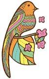 Oiseau sur la branche avec des feuilles et des fleurs Photographie stock libre de droits