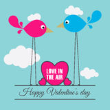 2 oiseaux avec le coeur pour la bannière Photographie stock