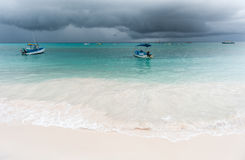 OISTINS, BARBADOS - MARCH 15, 2014: Miami Beach in Barbados with Cloudy Stormy Sky and Yacht, Boats in Background Royalty Free Stock Images