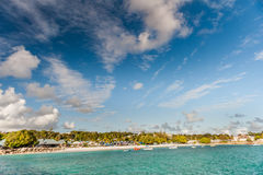 OISTINS, BARBADOS - MARCH 15, 2014: Miami Beach Landscape with Ocean Water Blue Sky Stock Photography