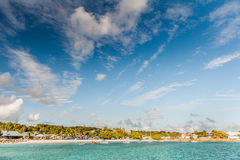 OISTINS, BARBADOS - MARCH 15, 2014: Miami Beach Landscape with Ocean Water Blue Sky and Local Restaurants Royalty Free Stock Images