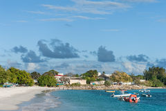 OISTINS, BARBADOS - MARCH 15, 2014: Miami Beach Landscape with Ocean Water and Boats Stock Photo