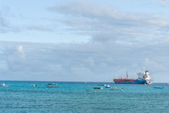 OISTINS, BARBADOS - MARCH 15, 2014: Miami Beach Landscape with Ocean Water and Boats, Oil Chemical Tanker Stock Photos