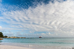 OISTINS, BARBADOS - MARCH 15, 2014: Miami Beach Landscape with Ocean Water and  Oil Chemical Tanker Stock Photos