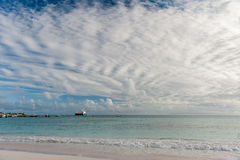 OISTINS, BARBADOS - MARCH 15, 2014: Miami Beach Landscape with Ocean Water and  Oil Chemical Tanker Stock Images