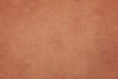 Ojämn apelsinpappersbakgrund royaltyfria bilder