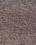 Ojämn bakgrund för texturtegelstenvägg Arkivfoto