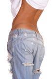 ojämn jeans arkivfoto