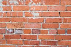 Ojämn röd tegelstenvägg Arkivbild