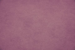 Ojämn violett lilapappersbakgrund fotografering för bildbyråer