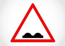 Ojämnt informationsvägmärke om varning Arkivbild
