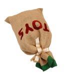 Ojca Christmas hessian zabawki worek wiązał z tasiemkowym łgarskim fla Obrazy Royalty Free