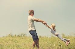 Ojca i córki spinnig Obraz Royalty Free