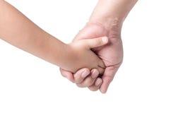 Ojca ` s ręki prowadzenie jego dziecko córka odizolowywająca zdjęcie royalty free