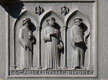 Ojcowie Reformowani kościół Szwajcaria: Dowódca, Haller, Blaurer, drzwi Grossmunster kościół w Zurich zdjęcia royalty free