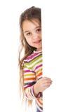 Ojeada de la muchacha hacia fuera de la bandera del vertica fotografía de archivo