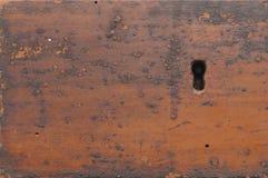 Ojo de la cerradura en viejo fondo de madera Imagen de archivo