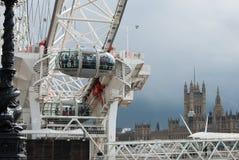 Ojo de Londres y casas del parlamento Imagen de archivo libre de regalías