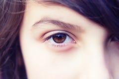 Ojo de una muchacha Imagenes de archivo