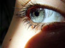 Ojo, luz y una sombra Fotos de archivo libres de regalías