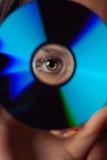 Ojo y disco compacto Imagen de archivo