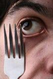Ojo y fork del hombre Imagen de archivo