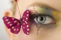 Ojo y mariposa imagen de archivo