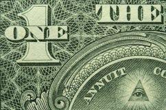 Ojo y UNO y de un billete de dólar de los E.E.U.U. uno fotografía de archivo libre de regalías